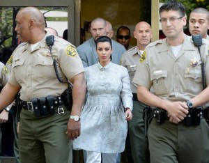 Kim leaves the courthouse under high security.  But where's Kris?